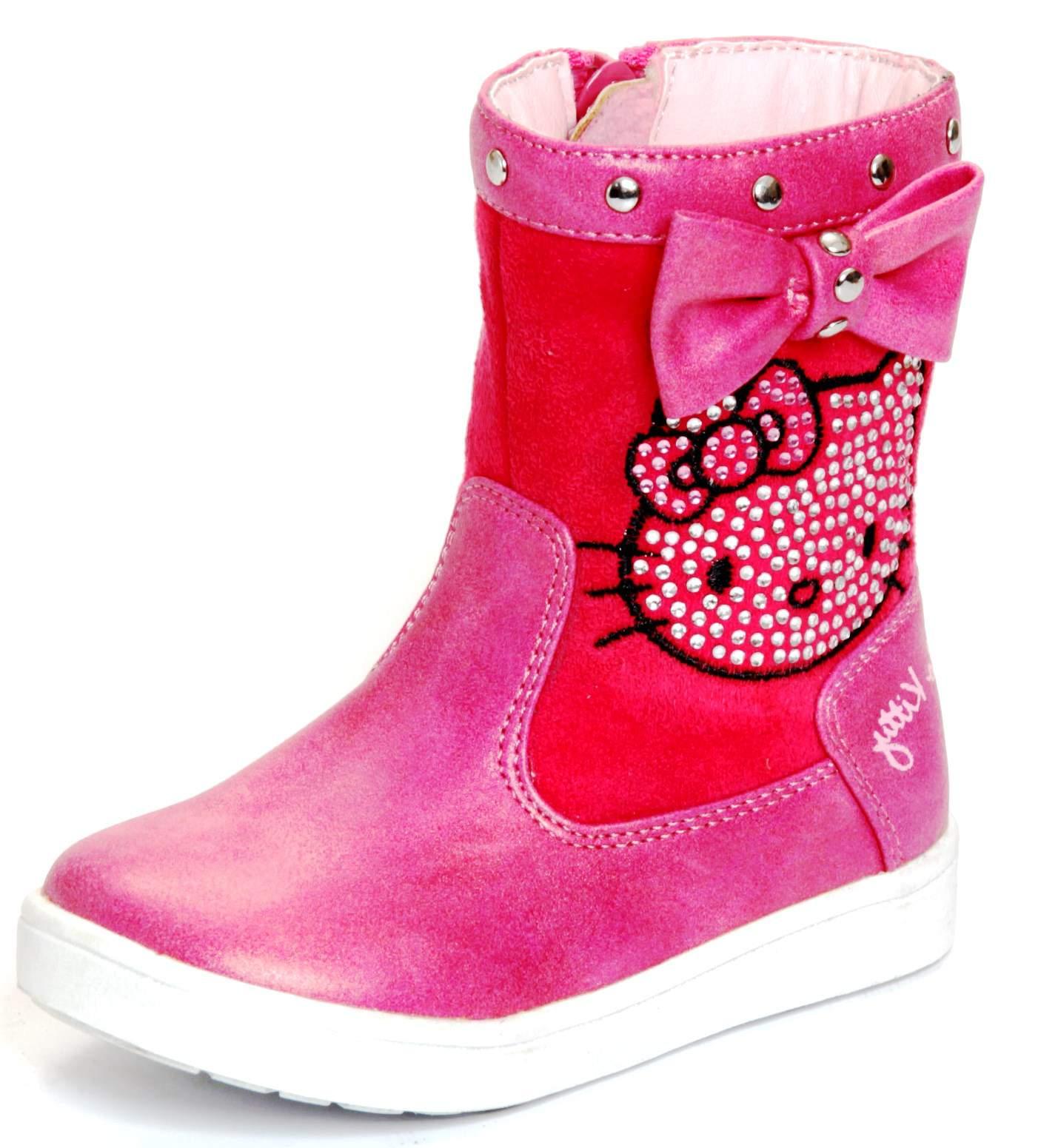 """פפיון ורוד. עור סגלגל וזמש אדום. """"הלו קיטי"""" בעיצוב ניטים. נעלי גלי. כ-220 שקלים. צילום: מנחם עוז"""